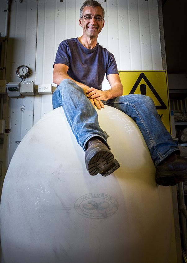 Bryan Martin sitting on a ceramic egg
